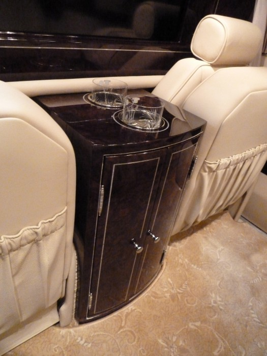 Luxury SUV limo mother of pearl Inlay into walnut burl veneer by Paul Schürch
